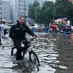 Wading Through Water To Eat Duck In Chengdu, China